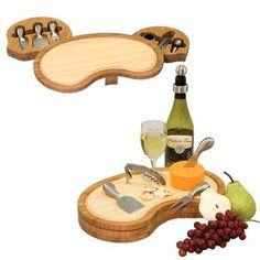 This two-toned cheese board includes wine and cheese accessories tucked away in two swing-out drawers.