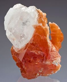 Sweet combo piece featuring a large orange Scheelite with attached Goshenite crystals!  The surfaces are lustrous and glassy. From Mt Xuebaoding, Pingwu Co., Mianyang Prefecture, Sichuan Province, China. Measures 6.5 cm by 5.6 cm by 5.2 cm in total size. Price $5500
