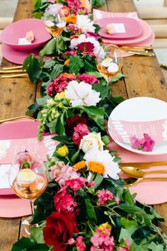 vibrant florals- a setting like this would look great with the new redwood tables at Venue at the Grove!