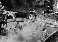 "Audrey Hepburn Takes a Bath  Audrey Hepburn takes a bath in 1964's ""Paris When It Sizzles."" Though she enjoyed making it, it was reportedly the least favorite of her films."