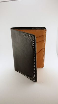 Men's Leather Two Fold Wallet. Hand stitched leather wallet made with 100% vegetable-oil tanned leather.