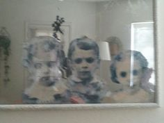 How To Make a Haunted Mirror - great tutorial for a creepy ghost kid mirror.  I'd look for a more round or oval  frame to look like an old timey mirror and probably fray the edges of the paper before I glue them on.  Love this!