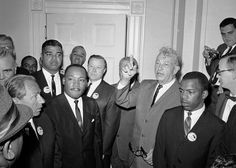 A Baptist minister, King led the civil rights movement by peacefully pursuing a vision of racial justice.