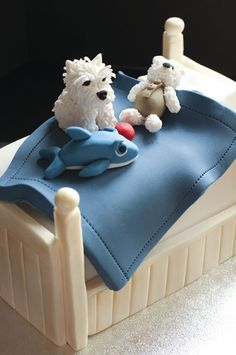 OMH this is a cake!!! SO cute! Juliet Stallwood cakes & biscuits:  Westie on bed