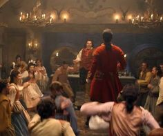 """And here's footage of live-action Le Fou (played by Josh Gad) and towering Gaston (played by Luke Evans) singing the """"Gaston"""" song."""""""