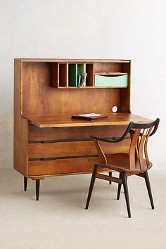no real need but love these retractable desks (carl's office area??)  Retractable Writing Desk - anthropologie.com
