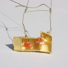 """Hares in the box"" by Andrea Wippermann. 2004. Gold, coral, textile."
