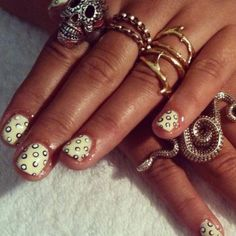 Polka dot nails, and so many wonderful rings.
