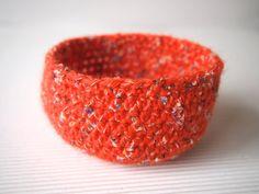 Bright orange crocheted bowl