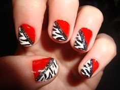 Black and white print with red nails