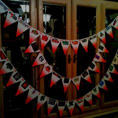 Make your own WWE pennant banner! Create a pennant triangle then copy logos and images from the Internet from your favorite wrestlers and pay per views. Then cut out and punch holes then string on ribbon. We did about 40 of them. Very cute!!! Could be used for any kind of event.