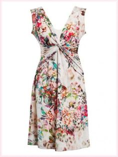 Ana Alcazar - white jersey dress with flower prints on it. Nice to wear for the next summer.