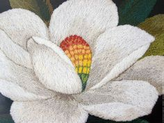 Nature is the principal theme for the Japanese art of punch needle known as Bunka Shishu. American Bunka has incorporated elements of a country's popular culture. Pictured here are the details of a big white flower, the magnolia grandiflora.