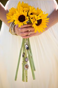 Sunflowers make us happy. Photography: Kathryn Krueger Photography - www.kathrynkrueger.com, Floral Design: Kindred Event Studio - kindredeventstudio.com  Read More: http://www.stylemepretty.com/southwest-weddings/2014/04/23/simple-sweet-park-wedding/