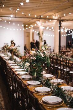 Vintage Wedding These long wooden tables feature greenery table runners lush and moody floral centerpieces Table Arrangements, Table Centerpieces, Floral Centerpieces, Table Decorations, Wedding Decorations, Centrepieces, Indoor Wedding Receptions, Wedding Reception Flowers, Outdoor Weddings