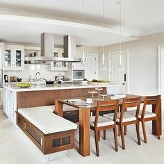 Island/benches combination This kitchen features an island combined with a fixed bench, table and chairs. Kitchen by Smallbone of Devizes