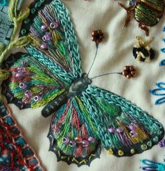 Gorgeous embroidered butterfly - everything on the page is beautiful - crazy quilting with embroidery, butterfly/bee/beetles *********************************************** CRAZY QUILTING INTERNATIONAL - ideas de decoracion frozen t√ Silk Ribbon Embroidery, Crewel Embroidery, Cross Stitch Embroidery, Embroidery Patterns, Butterfly Embroidery, Butterfly Quilt, Butterfly Food, Embroidered Butterflies, Butterfly Stitches