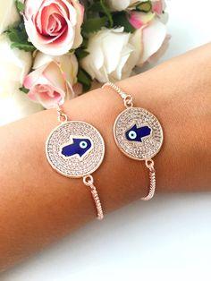 https://www.etsy.com/listing/556933127/evil-eye-bracelet-hamsa-bracelet-hamsa Evil eye bracelet, hamsa bracelet, hamsa disc bracelet, adjustable bracelet, rose gold bracelet, evil eye charm bracelet, hamsa jewelry This hamsa bracelet is totally handmade. This bracelet include; - blue evil eye hamsa hand figure - stainless steel rose gold disc - adjustable chains #evileyebracelet #hamsabracelet #discbracelet #rosegoldbracelet #hamsajewelry #stainlessbracelet #charmbracelet #evileyes #evileye