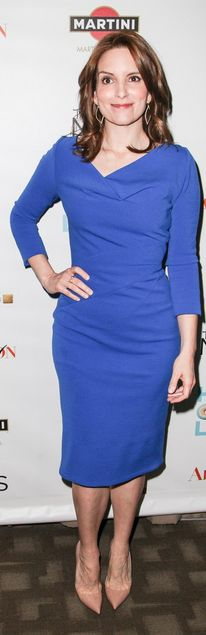 Tina Fey: Dress – Oscar De La Renta    Earrings – Jamie Wolf    Rings – Pandora    Shoes – Christian Louboutin