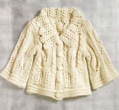 Knitted jacket made with a pleasant combination of crochet and knitting.