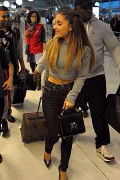 Ariana Grande. LOVE her Louis Vuitton suitcase!