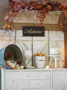 Distressed shutters and shelves make great backdrops and ledges for faux fall leaves and other autumn-inspired decor.