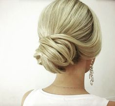 Sophisticated chignon for a low bun updo wedding hairstyle. via Elstile