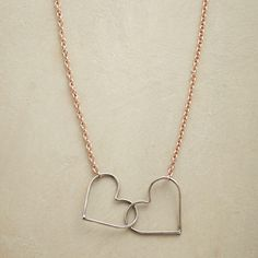 """HEART CONNECTION NECKLACE--Two oxidized sterling silver hearts are forever joined, suspended between delicate links of 14kt rose gold filled. Spring ring clasp of oxidized silver. Sundance exclusive handmade in USA. 16-1/2"""" to 17-1/2""""L."""