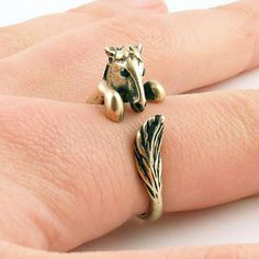 This gold Horse ring is slightly adjustable with a gentle squeeze. It fits a size 5-9. He is sweet with Swarovski black Crystals eyes and mane as this little guy wraps around your finger, the other end with a full tail. (Solid Bronze with patina.)  This little guy is stronger than other version...