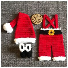 Crochet Santa Newborn Baby outfit/costume. This sweet set is Size newborn. This set includes: -A Santa hat in red with white fuzzy trim & a pom pom sewn onto the end of the hat. -A pair of red pants with a black inspired belt & yellow gold belt buckle. The pants are trimmed in white