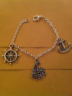 Nautical  pin up ship wheel anchor charm bracelet perfect by SPS22, £1.50