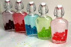 Jolly Rancher Vodka is one of the easiest and quickest candy liquor infusions you can do. Check out my simple, four-step tutorial. It makes a great gift, too. Vanilla Vodka Drinks, Vodka Mixed Drinks, Liquor Drinks, Vodka Cocktails, Fun Drinks, Alcoholic Drinks, Cocktail Drinks, Liquor Candy, Vodka Martini