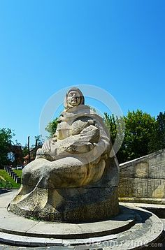 The Romanian soldier monument, in the park, against the blue sky, female statue with child in her arms,in the city of Baia Mare, next to Sasar river, the capital of Maramures County.