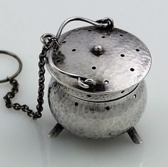 Fradley antique sterling silver teaball with a hammered finish and three supporting legs, lid on small hinge, from 1866 or later. Early in the 19th C. tea infusers became popular and were made in many different styles. This plain solid example would have been ideal for travelling and bivouacs. Offered by Britannia Fine Antique Silver