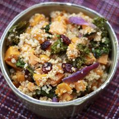 Quinoa salad with Sweet Potatoes, Butternut Squash, Kale, Red Onion, and Craisins.