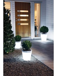 Enhance your front yard with these awesome glowing planters: - Yard Decorating ideas solar lights