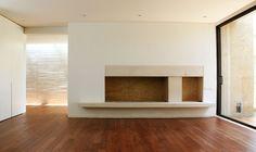 Contemporary concrete fireplace. SoNA.