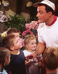 "Gene Kelly helping the French kids to sing ""I Got Rhythm"" in ""An American In Paris"""