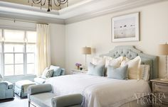 Celadon green is Karrie's favorite color, so Amy filled the airy master bedroom with the hue via a headboard by AMD, Matouk bed linens and twin club chairs from Lee Industries.