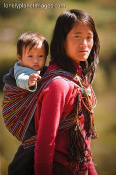 Bhutanese woman and child, Bhutan.