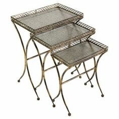 "Set of 3 wrought iron and glass nesting tables with openwork siding.          Product: Small, medium and large nesting table  Construction Material: Wrought iron and glass  Color: Distressed gold  Dimensions: 24.25"" H x 18.25"" W x 12.25"" D (overall)"