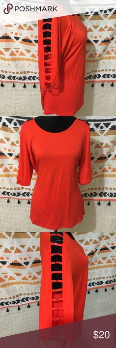 Bright orange-red top with cutout sleeves Super cute top with 3/4 length sleeves with ladder cutouts and studs! Excellent condition! Please excuse the wrinkles! Cable & Gauge Tops