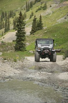 FJ40 Toyota Land Cruiser off roading in the mountains and creeks