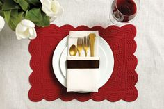 Bright red placemats feel festive when paired with gold flatware