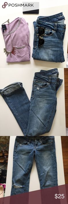 "AE medium wash skinny kick jeans American Eagle medium wash destroyed jeans. Fit is ""skinny kick"" they are skinny jeans that have a slight flare at the bottom. They don't make this fit anymore. The back pockets have some sparkle to them. American Eagle Outfitters Jeans"