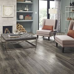 Vintage Pewter Oak natural laminate floor with wear and spill protection. Grey oak wood finish, 10mm thick, 1-strip plank laminate flooring, 10-year warranty.