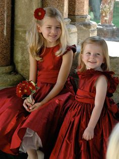 There's nothing that says Christmas wedding like these beautiful red silk flower girl dresses!