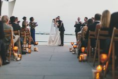 James & Ayn's wedding by Miele Events. Ceremony on the South Carolina Aquarium's Harbor Overlook. Photography by Hyer Images.