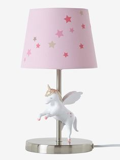 Straight from a magical world, a beautiful unicorn lands on the base of this bedside lamp! The perfect way to make your child's nights... magical! SIZE: Height 31.5 cm. With switch on the cable. Transformer included. Polypropylene covered in fabric. Metal base and stand. Resin unicorn. ;