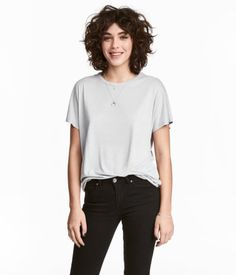 Light gray. Wide-cut top in soft, crêped viscose jersey with cap sleeves and a gently rounded hem.